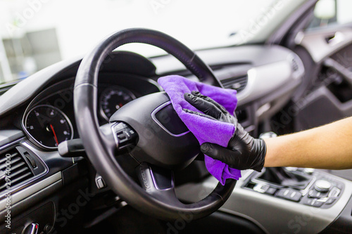 Canvastavla A man cleaning car interior, car detailing (or valeting) concept