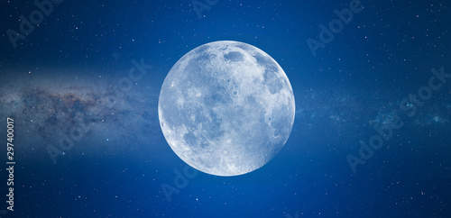 Cuadros en Lienzo Blue full moon against milky way galaxy Elements of this image furnished by NAS