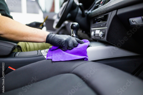 A man cleaning car interior, car detailing (or valeting) concept Fototapete