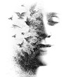 Double Exposure portrait of an elegant woman with closed eyes combined with hand made pencil drawing of a flock of birds flying freely resembling disintegrating particles of her being, black