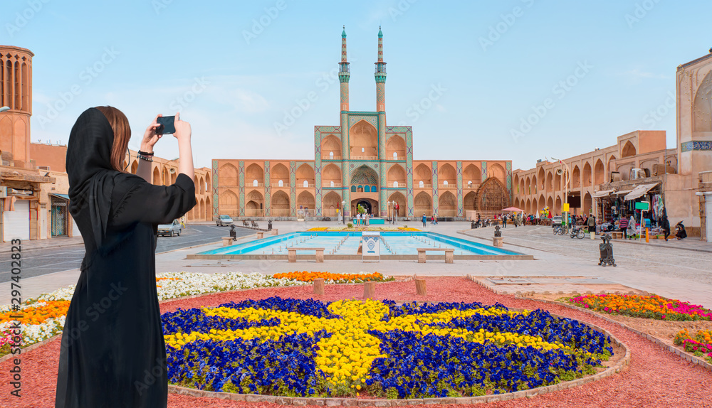 Fototapety, obrazy: Beautiful Iranian girl wearing abaya with taking selfie  - The Amir Chakhmaq Complex is a prominent structure in Yazd - IRAN