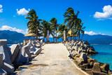 Beautiful sunny beach and road with columns on small Boundary island near Sanya, Hainan island, South China sea, China, Asia