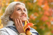 canvas print picture - Close up portrait of senior woman resting in park