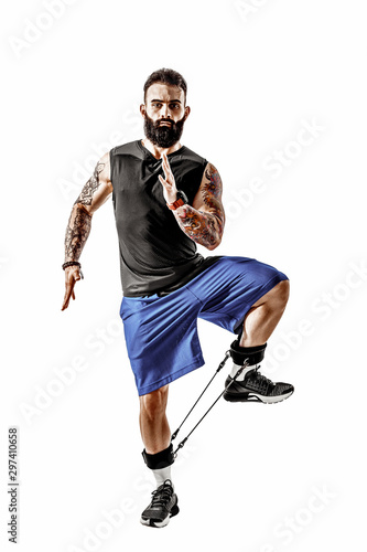 Carta da parati Young athlete squatting exercise with resistance band around legs