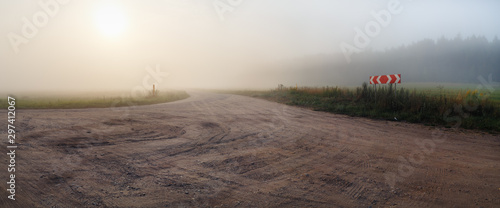 Gravel road and fog. Rural landscape. Panoramic shot.