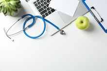 Stethoscope, Apple, Laptop And...