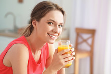 Young Woman Drinking Healthy Juice In Kitchen. Diet Concept