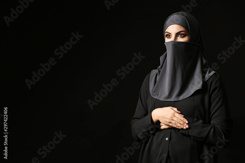Beautiful Muslim woman on dark background Canvas Print