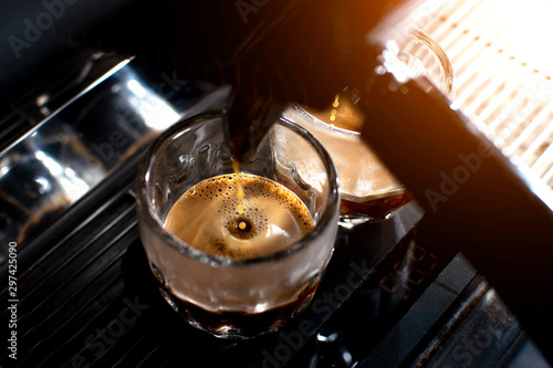 coffee machine makes double espresso in glasses, close-up of coffee preparation, фототапет