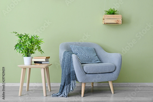 Photo Interior of modern room with armchair and table