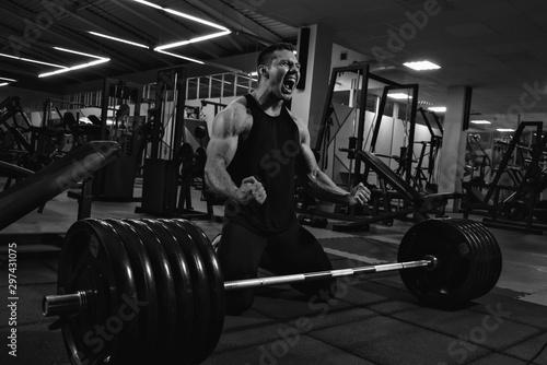 Obraz na plátně  Young man powerlifter after deadlift
