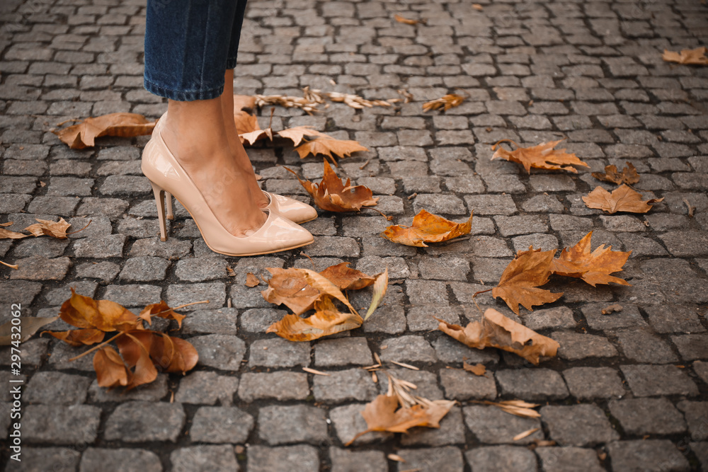 Fototapety, obrazy: Beautiful young woman in autumn city