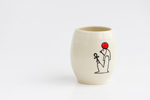 Clay Vase With The Ancient Egyptian Hieroglyph God Ra On A White Background
