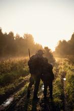 Rifle Hunter And His Son Silho...