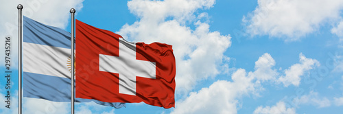 Spoed Foto op Canvas Buenos Aires Argentina and Switzerland flag waving in the wind against white cloudy blue sky together. Diplomacy concept, international relations.