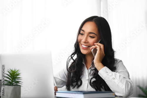 Photo  Young Asian woman working in office