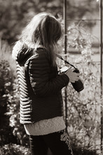 Black And White Portrait Of Young Female Photographing Hummingbirds