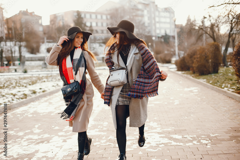 Fototapety, obrazy: Fashionable girls in a winter city. Stylish ladies in a coats