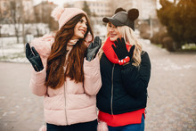 Fashionable Girls In A Winter City. Stylish Ladies In A Cute Jackets.