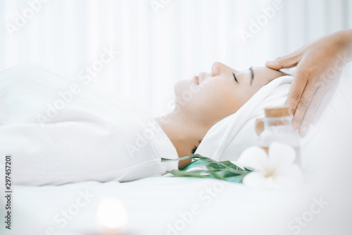 Montage in der Fensternische Spa Beautiful young woman lying down on beds massage and spa at asian spa massage and beauty salon center, spa concept, massage concept