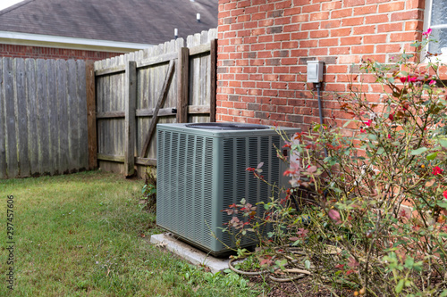 Air Conditioner system next to a home Canvas Print