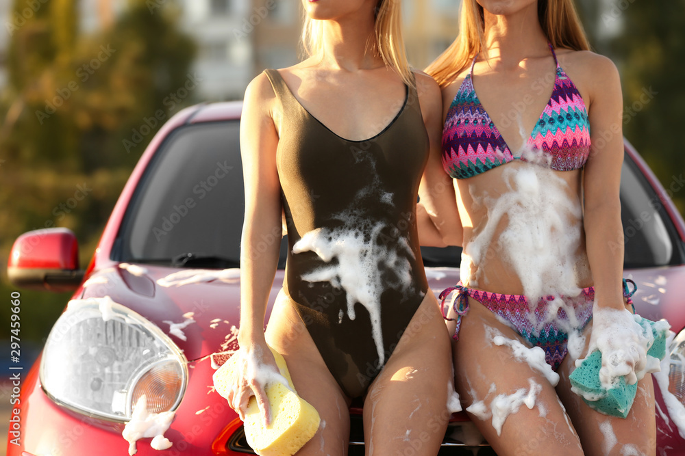 Fototapety, obrazy: Young women in swimsuits with sponges near car outdoors, closeup