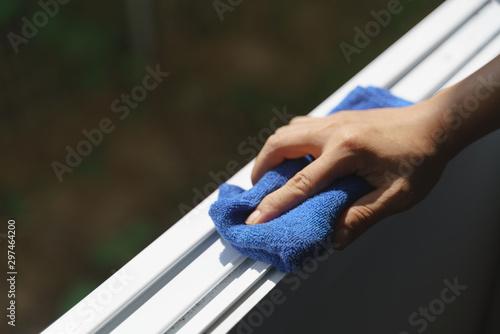 Fototapeta Hand holding microfiber cloth for cleaning obraz