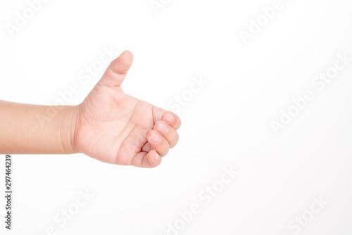 Kid hand holding something like a bottle Fototapet