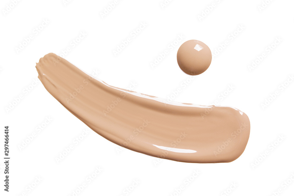 Fototapeta Liquid makeup foundation swatch isolated on white background. Skin tone  BB, CC cream swipe smear smudge. Cosmetic product creamy texture