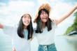 Leinwandbild Motiv two cheerful asian teenager happiness on vacation sea beach