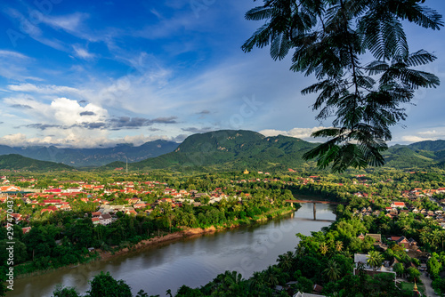Valokuva  Aerial view of Luang Prabang and surrounding mountains and the River Nam Kahn a tributary to the Mekong River taken from Mount Phou Si or Phou Si Hill