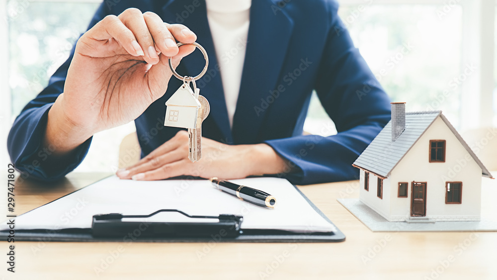 Fototapeta House model with real estate agent and customer discussing for contract to buy house, insurance or loan real estate background.