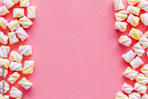 Sweets. Marshmallows frame on pink background top view copy space
