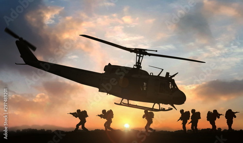Poster Helicopter Military special force assault team helicopter drops during sunset