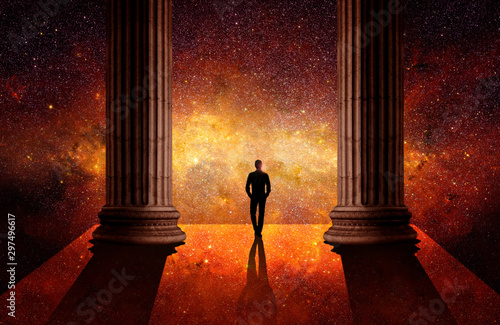 Photo Man between columns in front of the universe