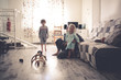 happy mom with two children on the floor in room