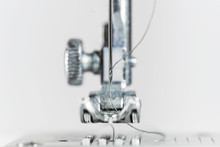 Needle And Presser Foot Of A Sewing Machine As Extreme Macro Shot, Technical Invention For The Clothing Industry, Bright Background With Copy Space, Selected Focus