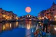 Gondola near Rialto Bridge with moonrise - Venice, Italy