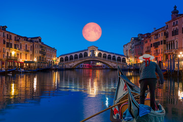 Fototapeta Mosty Gondola near Rialto Bridge with moonrise - Venice, Italy