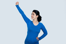 Brave Woman With Her Fist Raising Arm Hips Showing  Power Like A Superhero Isolated Over White Background. People Confidence Expression, Strength And Motivation Concept.