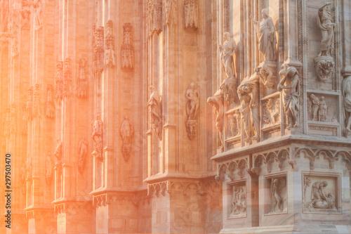 La pose en embrasure Con. Antique Decorated culptures outside Milan Duomo, Milan, Italy.