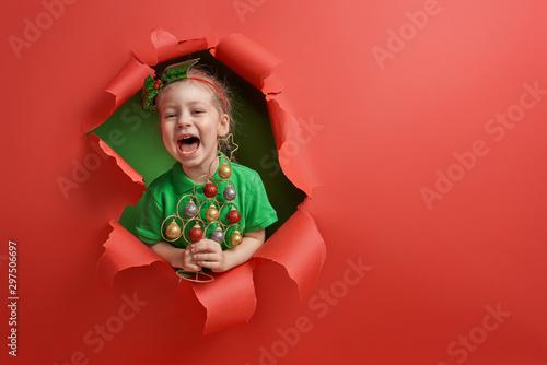 Foto  Santa's elf on bright color background