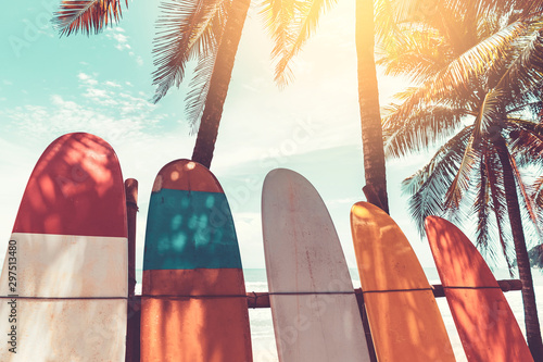 Surfboard and palm tree on beach background. Wallpaper Mural