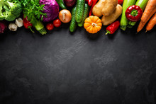 Culinary Background With Fresh Raw Vegetables On A Black Kitchen Table, Healthy Vegetarian Food Concept, Flat Lay Composition, Top View