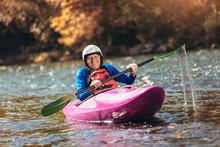 Active Senior Man Paddling Kayak. Gray Hair Man Enjoy River Kayaking.
