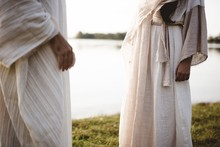 Closeup Shot Of Two People Wearing A Biblical Robe With A Blurred Background