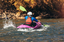 Man Rafts On A Kayak On The River In A Sunny Day.