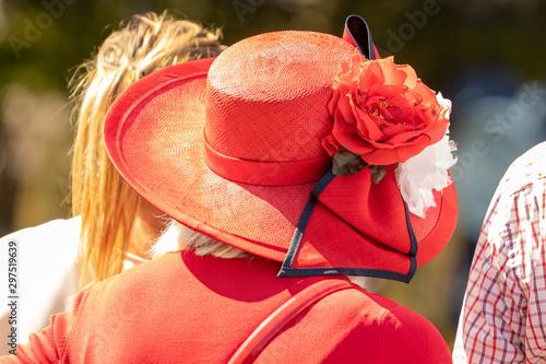Fotografia Frau mit roten Hut