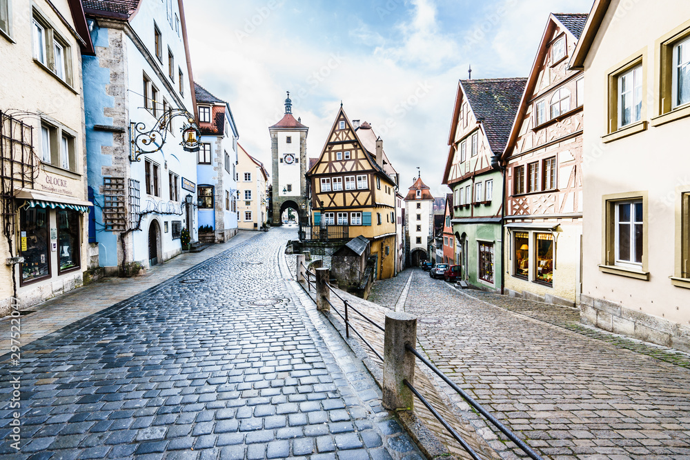 ROTHENBURG OB DER TAUBER, GERMANY - MARCH 05: Typical street on March 05, 2016 in Rothenburg ob der Tauber, Germany. It is well known for its well-preserved medieval old town.