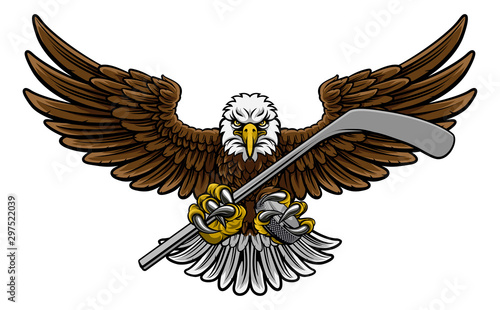 Photo  An eagle ice hockey player animal sports mascot holding a hockey stick and puck